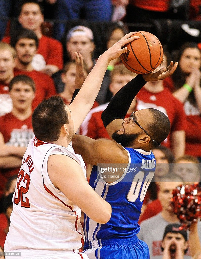 Gregory Echenique #0 of the Creighton Bluejays has his shot blocked by Andre Almeida #32 of the Nebraska Cornhuskers during their game at the Devaney Center on December 6, 2012 in Lincoln, Nebraska. Creighton defeated Nebraska 64-42.