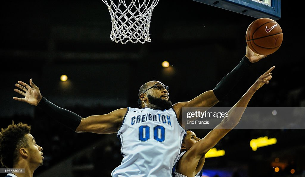Gregory Echenique #0 of the Creighton Bluejays pulls in a rebound over Michael Kessens #14 of the Longwood Lancers during their game at CenturyLink Center on November 20, 2012 in Omaha, Nebraska.