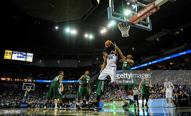 Gregory Echenique of the Creighton Bluejays take the ball to the hoop over KC Whitaker of the UAB Blazers during their game at CenturyLink Center on...