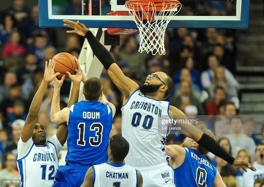 Gregory Echenique #00 of the Creighton Bluejays tries to block the shot of Jake Odum #13 of the Indiana State Sycamores during their game at the CenturyLink Center on January 5, 2013 in Omaha, Nebraska. Creighton defeated Indiana State 79-66.