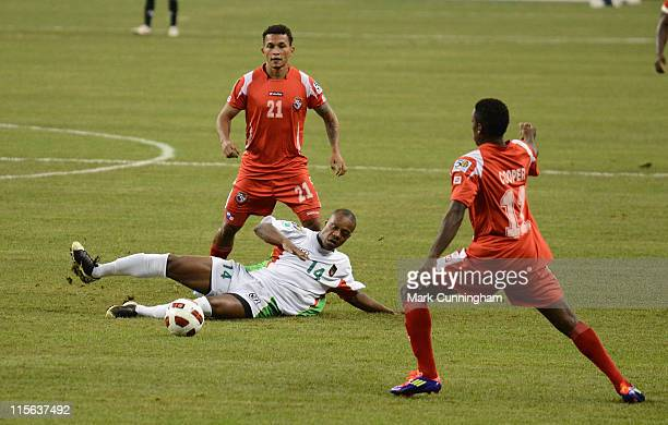 Gregory Gendrey of Guadeloupe tries to control the ball between Amilcar Henriquez and Armando Cooper of Panama during the 2011 CONCACAF Gold Cup...
