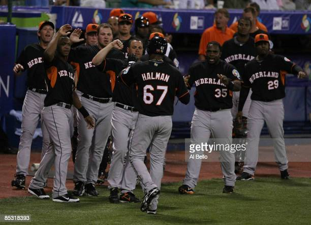 Gregory Halman of The Netherlands celebrates scoring a run against Puerto Rico in the first inning during the 2009 World Baseball Classic Pool D...