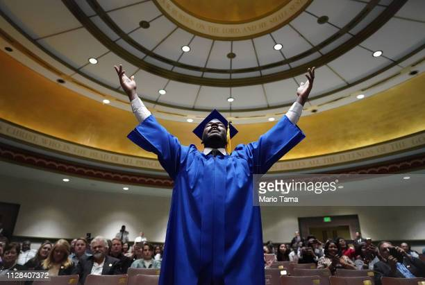 Gregory Harris leads fellow members of the 100th graduating class of the Los Angeles Mission located in Skid Row in song during their commencement...
