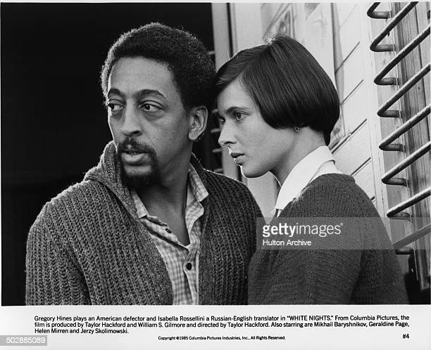 Gregory Hines stands with Isabella Rossellini in a scene for the movieWhite Nights circa 1985