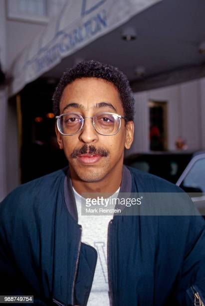 Gregory Hines stops to take pictures and sign autographs for fans outside the Jockey Club prior to the annual brunch for the Kennedy Center Honorees...