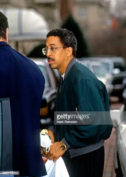 Gregory Hines stops to take pictures and sign autographs for fans outside the Jockey Club prior to the annual brunch for the Kennedy Center Honorees,...