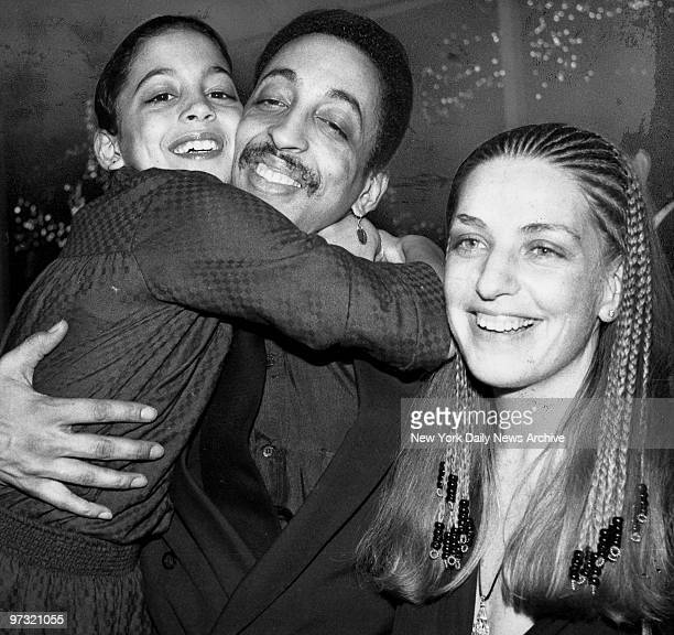 "Gregory Hines with daughter Daria and wife Pamela during opening night party for ""Sophisticated Ladies"" at Tavern on the Green, 21st March 1981."