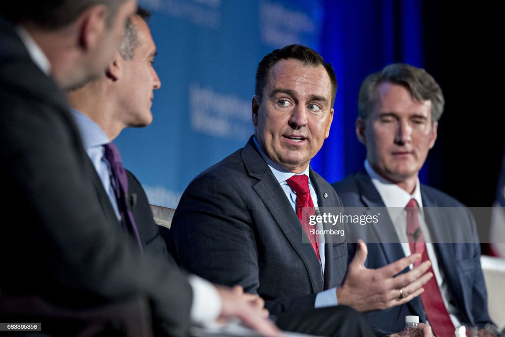 Gregory Hughes, speaker of the Utah state legislature, speaks as Glenn Youngkin, president and chief operating officer of the Carlyle Group, right, listens during a panel discussion at the Infrastructure Week kickoff event at the U.S. Chamber of Commerce in Washington, D.C., U.S., on Monday, May 15, 2017. States and localities that have secured some funding and financing of their own for infrastructure work will be given higher priority access to federal funds under President Trump's forthcoming plan, Transportation Secretary Elaine Chao said during her speech at the event. Photographer: Andrew Harrer/Bloomberg via Getty Images