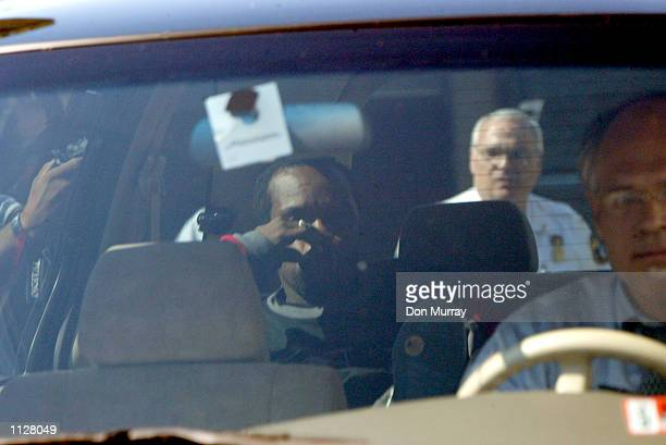 Gregory Iverson uncle of Philadelphia 76ers' Allen Iverson is driven away from police headquarters after the two were arraigned July 16 2002 in...
