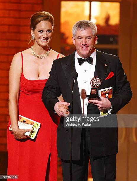 Gregory Jbara accepts the award for Best Performance by a Featured Actor in a Musical for Billy Elliot The Musical with his wife Julie onstage during...