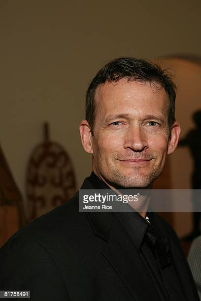 Gregory Joiner attends the Trigg Ison Fine art exhibit for the work of Maxine Kim StussyFrankel at her home June 28 2008 in Los Angeles California