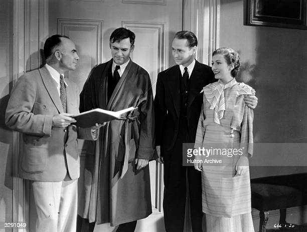 Gregory La Cava directs Walter Huston Franchot Tone and Karen Morley on the set of MGM's 'Gabriel Over The White House' a light political satire