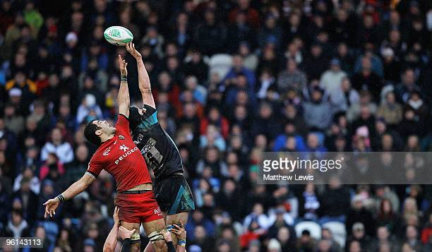 Gregory Lamboley of Toulouse and James Gaskell of Sale challenge for the ball during the Heineken Cup match between Sale Sharks and Toulouse at...