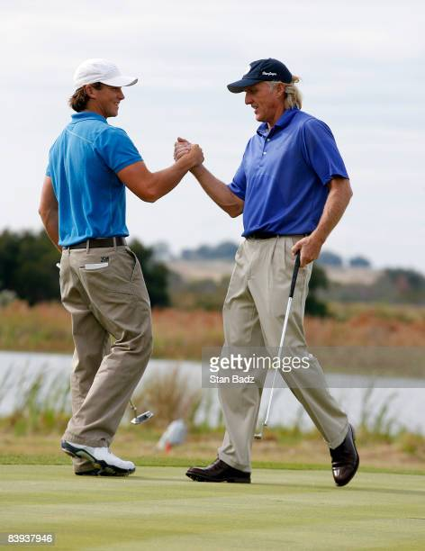 Gregory Norman and his father Greg shake hands on the 18th green after the first round of the Del Webb Father/Son Challenge on the International...