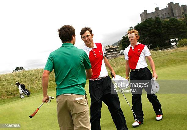 Gregory Payne and Curtis Griffiths of England shake hands during the Boys Home International at Royal St David's Golf Club on August 04 2011 in...