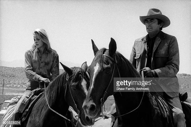 Gregory Peck and Camilla Sparv on horseback during the filming of Mackenna's Gold in 1969
