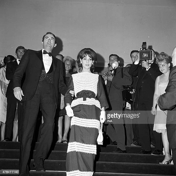 """Gregory Peck and his wife Veronique Passani on the walking of the palace during the projection of its movie """"""""Of the silence and the shadows"""""""""""