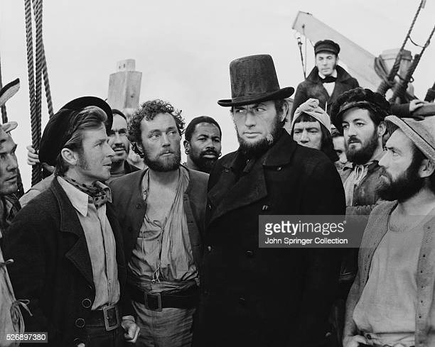 Gregory Peck as Captain Ahab surrounded by his doomed crew in Moby Dick.
