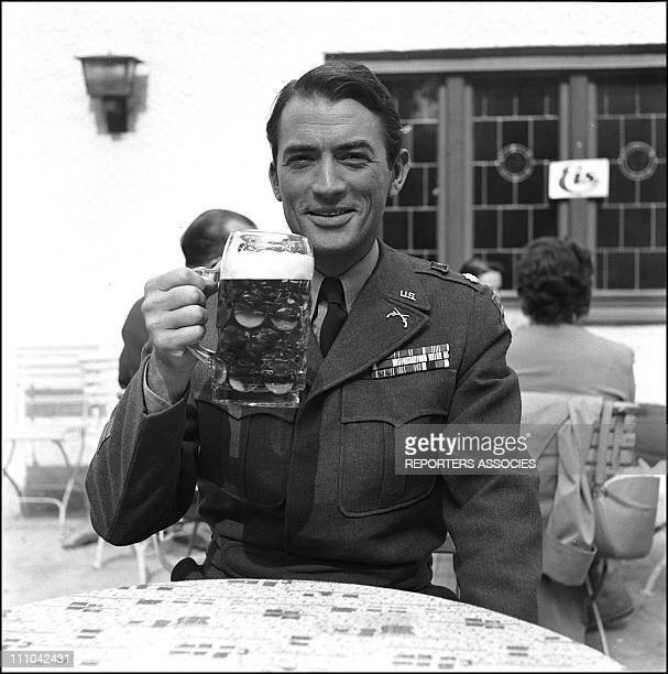 Gregory Peck as soldier drinking a beer in Italy on December 31 1950