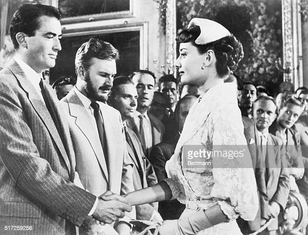Gregory Peck Eddie Albert and Audrey Hepburn in a scene from the movie Roman Holiday