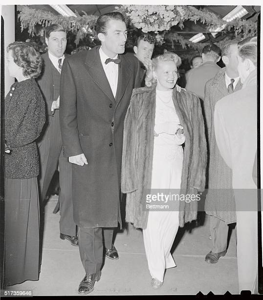 Gregory Peck escorting his lovely wife attends premiere of new film Duel in the Sun in which he stars