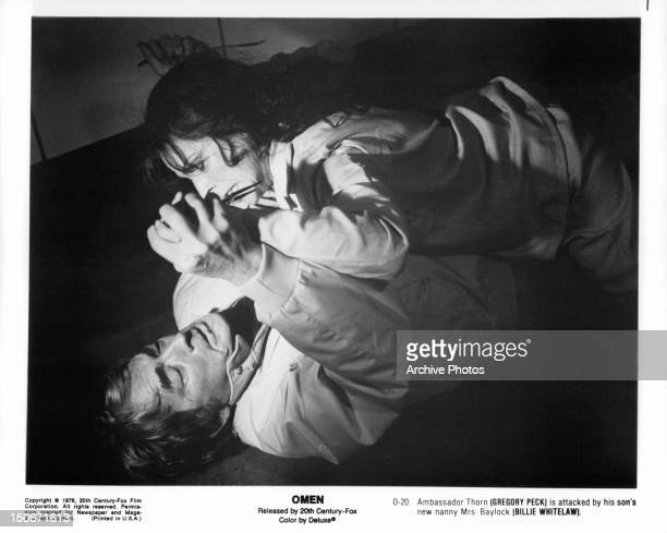 Gregory Peck is attacked by Billie Whitelaw in a scene from the film 'The Omen', 1976.