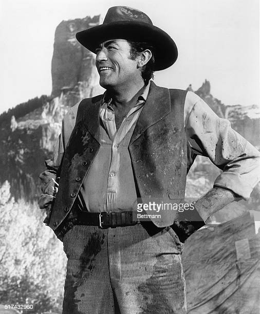 Gregory Peck is one of the dozen top stars in MetroGoldwynMayerCinerama's great production 'How The West Was Won' Peck is shown here with background...