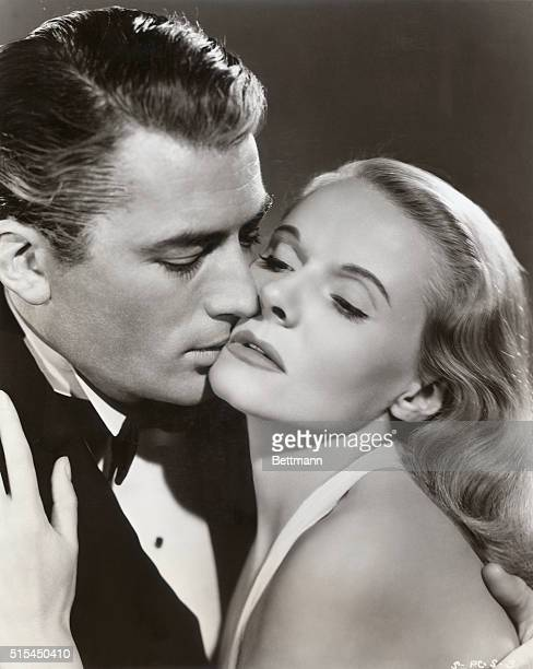 Gregory Peck kisses costar Ann Todd during the filming of David O Selznck's motion picture The Paradine Case where they play the roles of Sir Anthony...