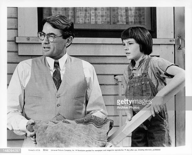 Gregory Peck standing next to Mary Badham in a scene from the film 'To Kill A Mockingbird' 1962