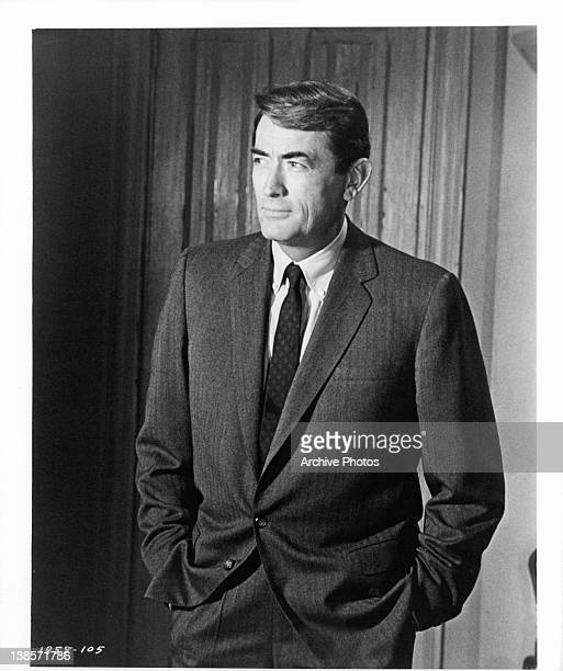 Gregory Peck standing with his hands in his pockets in a scene from the film 'Mirage' 1965