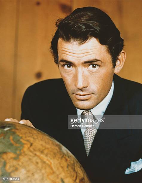 Gregory Peck Touching a Globe