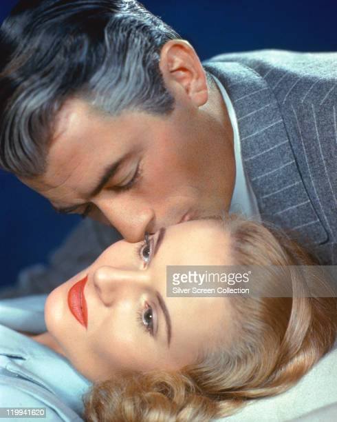 Gregory Peck US actor kisses Ann Todd British actress in a publicity still issued for the film 'The Paradine Case' 1947 The courtroom drama directed...