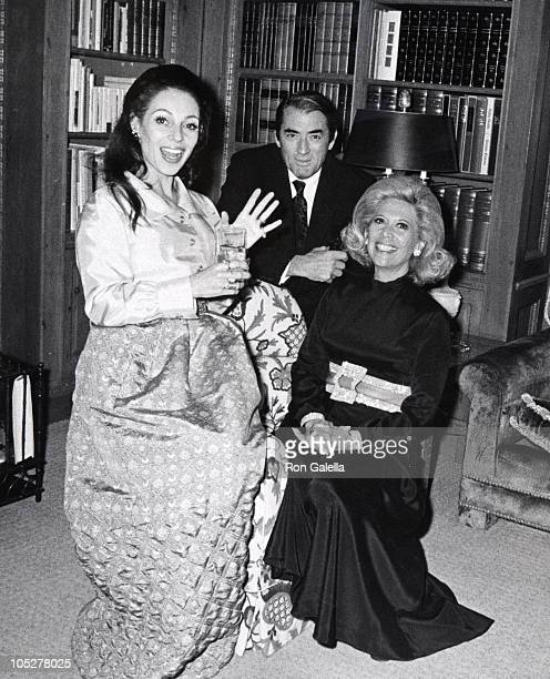 """Gregory Peck, wife Veronique, & Dinah Shore during """"If It's Tuesday, This Must Be Belgium"""" Los Angeles Premiere and After Party at Cinema Room at the..."""