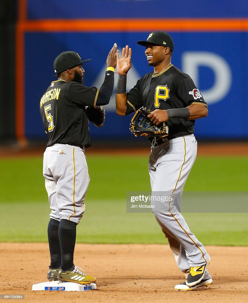 Gregory Polanco #25 and Josh Harrison #5 of the Pittsburgh Pirates celebrate after defeating the New York Mets at Citi Field on June 2, 2017 in the Flushing neighborhood of the Queens borough of New York City.