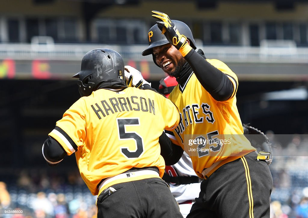 Gregory Polanco #25 celebrates his two run home run with Josh Harrison #5 of the Pittsburgh Pirates during the fifth inning against the Cincinnati Reds at PNC Park on April 8, 2018 in Pittsburgh, Pennsylvania.