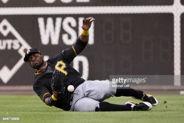Gregory Polanco of the Pittsburgh Pirates cannot make the catch on a ball hit by Rhys Hoskins of the Philadelphia Phillies in the bottom of the...