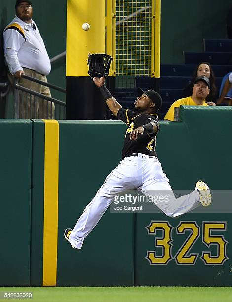 Gregory Polanco of the Pittsburgh Pirates can't make a catch on a ball hit by Joe Panik of the San Francisco Giants during the sixth inning on June...