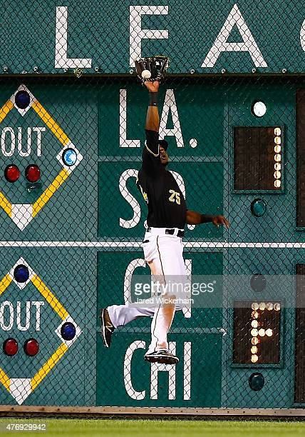 Gregory Polanco of the Pittsburgh Pirates catches a fly ball at the right field wall against the Philadelphia Phillies during the game at PNC Park on...