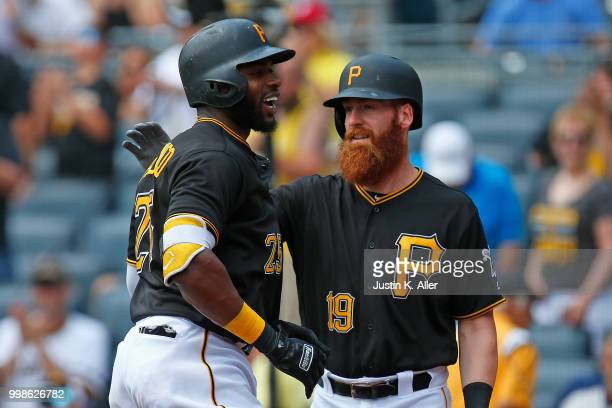 Gregory Polanco of the Pittsburgh Pirates celebrates after hitting a home run in the first inning with Colin Moran during game one of a doubleheader...