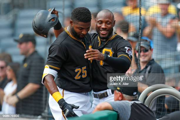 Gregory Polanco of the Pittsburgh Pirates celebrates after hitting a home run in the first inning with Gregory Polanco during game one of a...