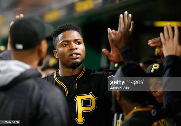 Gregory Polanco of the Pittsburgh Pirates celebrates after scoring on throwing errorat against the Milwaukee Brewers PNC Park on May 5 2017 in...