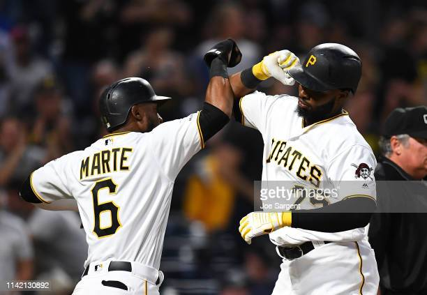 Gregory Polanco of the Pittsburgh Pirates celebrates his two run home run with Starling Marte during the fifth inning agains the Texas Rangers at PNC...