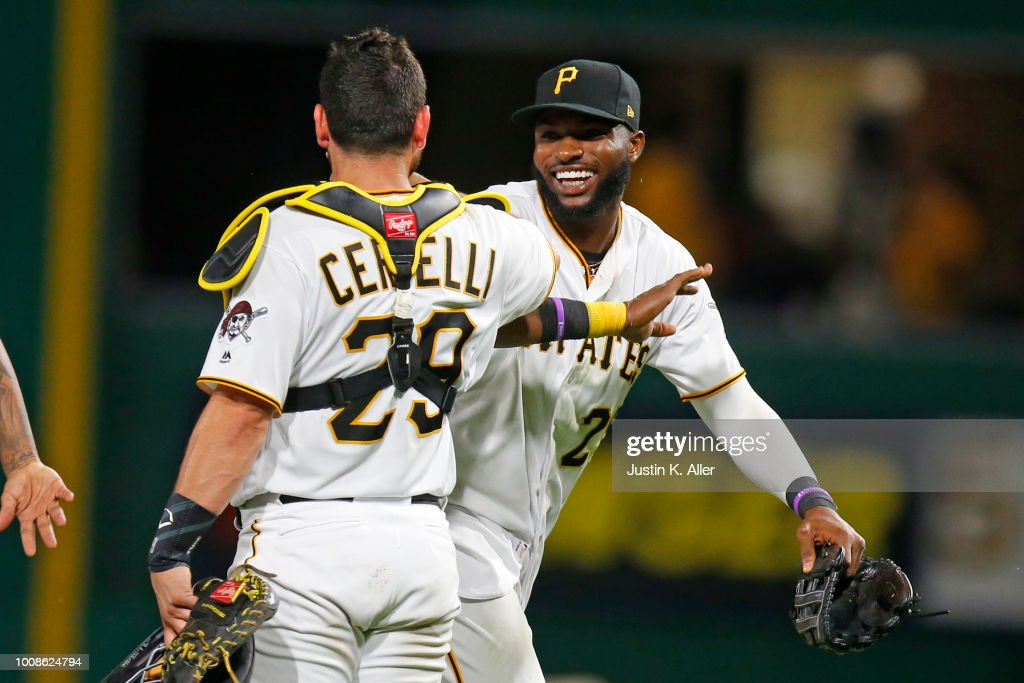 Gregory Polanco #25 of the Pittsburgh Pirates celebrates with Francisco Cervelli #29 after defeating the Chicago Cubs at PNC Park on July 31, 2018 in Pittsburgh, Pennsylvania.