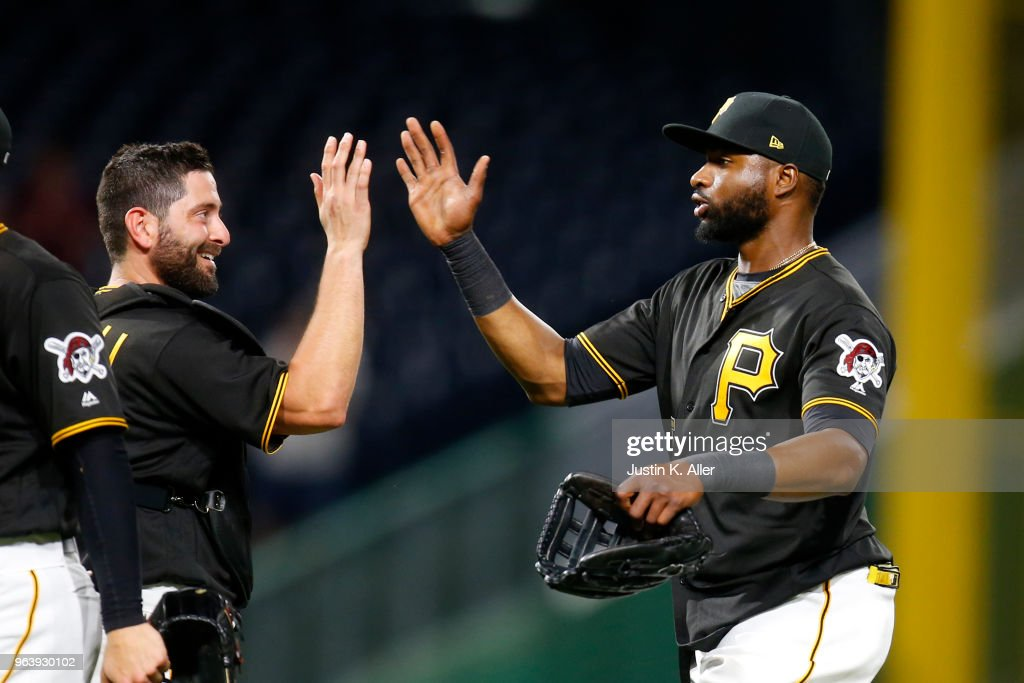 Gregory Polanco #25 of the Pittsburgh Pirates celebrates with Francisco Cervelli #29 after defeating the Chicago Cubs 2-1 at PNC Park on May 30, 2018 in Pittsburgh, Pennsylvania.