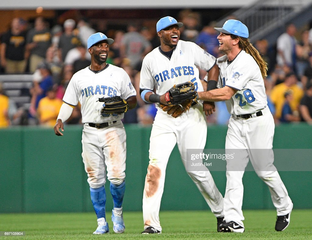 Gregory Polanco #25 of the Pittsburgh Pirates celebrates with John Jaso #28 and Andrew McCutchen #22 after the final out in the Pittsburgh Pirates 4-3 win over the Chicago Cubs at PNC Park on June 17, 2017 in Pittsburgh, Pennsylvania.