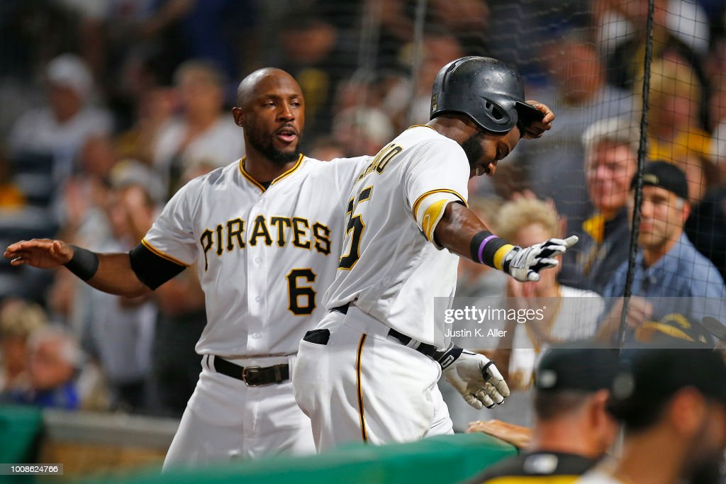 Gregory Polanco #25 of the Pittsburgh Pirates celebrates with Starling Marte #6 after Polanco's solo home run in the eighth inning against the Chicago Cubs at PNC Park on July 31, 2018 in Pittsburgh, Pennsylvania.