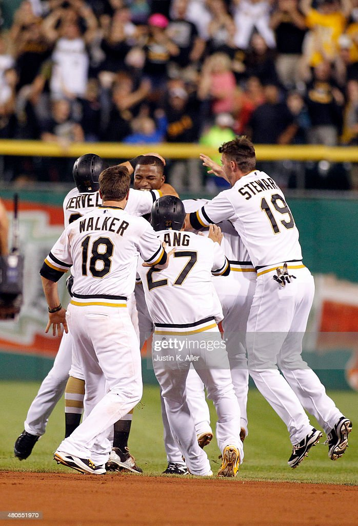 Gregory Polanco #25 of the Pittsburgh Pirates celebrates with teammates after hitting a walk off single in the tenth inning during the game against the St. Louis Cardinals at PNC Park on July 12, 2015 in Pittsburgh, Pennsylvania.