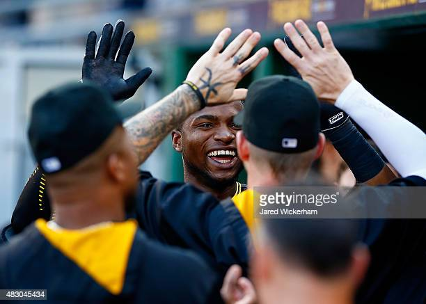Gregory Polanco of the Pittsburgh Pirates celebrates with teammates in the dugout after scoring in the first inning against the Chicago Cubs during...