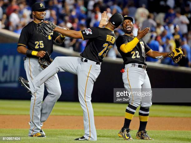 Gregory Polanco of the Pittsburgh Pirates Felipe Rivero and Andrew McCutchen celebrate their win over the Chicago Cubs after the game at Wrigley...