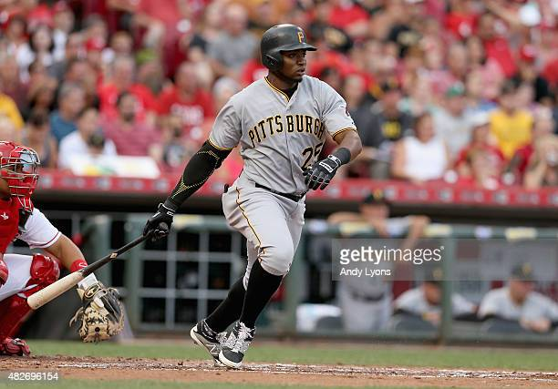 Gregory Polanco of the Pittsburgh Pirates hits a single in the third inning against the Cincinnati Reds at Great American Ball Park on August 1 2015...